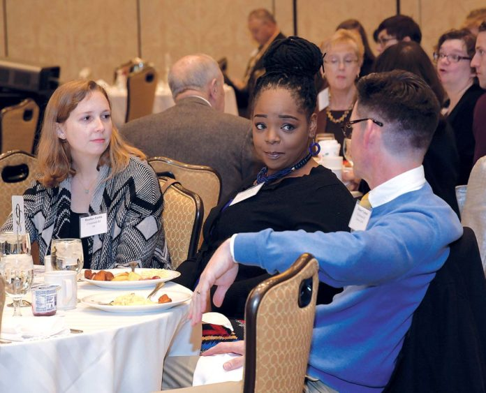 CONVERSING: Crossroads Rhode Island members, from left, Heather Fortin, human resources and individual volunteer coordinator; Cicely Dove, vice president of family services; and Robert Upham, director of human resources, attend the PBN Workplace Excellence, Diversity and Inclusion Summit held Dec. 7 at the Crowne Plaza Providence-Warwick. / PBN PHOTO/MICHAEL SKORSKI