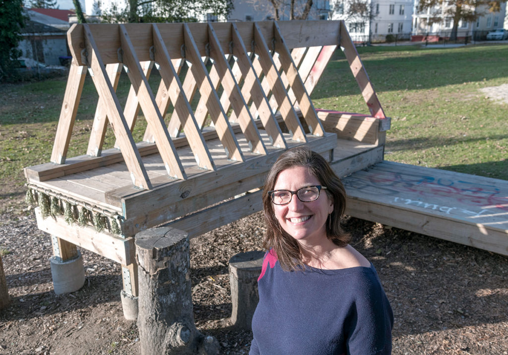 CREATIVE DESIGN: Adrienne Gagnon, executive director of DownCity Design, stands in front of the creative-play structure built by DownCity participants at Ellery Park in Providence. / PBN PHOTO/MICHAEL SALERNO