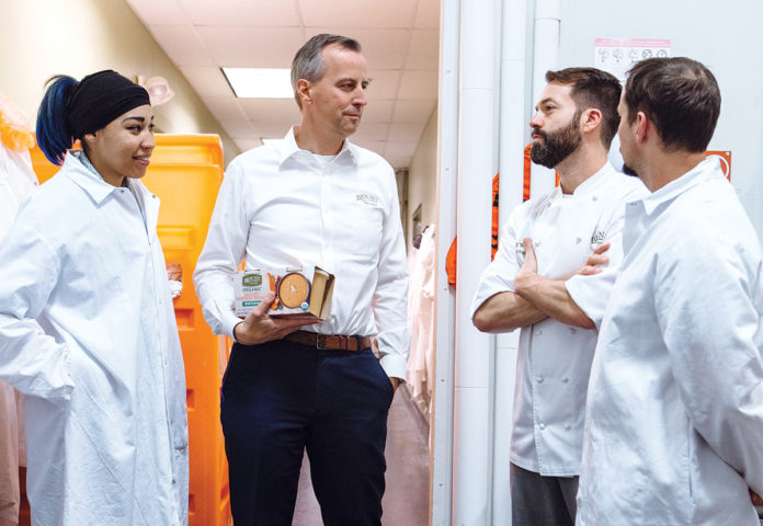 NEW PRODUCTS: Todd Blount, president of Blount Fine Foods, and his team originally made recipes as instructed by customers and partners, but over the last five years the company has developed a deep innovation process resulting in new products. From left: Sashaira Ramirez, production supervisor; Blount; and senior directors of culinary development Jeff Wirtz and Quinn Corbett. / PBN PHOTO/RUPERT WHITELEY