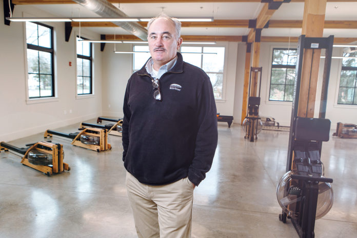 SUSTAINED GROWTH: Peter King is president and CEO of WaterRower Inc., a rowing-machine manufacturer that has quadrupled its workforce over the past five years and is still hiring. / PBN PHOTO/RUPERT WHITELEY
