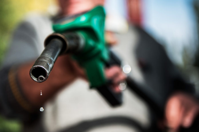 RHODE ISLAND REGULAR GAS prices declined 3 cents this week to average $2.56 per gallon. Massachusetts prices climbed 1 cent to $2.49 per gallon. / BLOOMBERG FILE PHOTO/AKOS STILLER