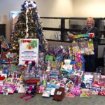 FOR THE 20TH YEAR, Bank Rhode Island's annual Holiday Giving Tree program has helped to brighten the season for underprivileged children, providing more than 1,500 gifts to kids across the state. The bank's West Shore Road branch in Warwick led the charge, collecting 296 gifts for children served by the Boys & Girls Clubs of Warwick. From left: Monique Rossi, Boys & Girls Clubs of Warwick; Lori Lepizzera, Buttonwoods assistant branch manager, BankRI; Alexander Jackson, universal banker, BankRI; Ashley Wilson, senior teller, BankRI; Paula Pratt, Buttonwoods branch manager, BankRI; Christopher Metcalf, teller supervisor, BankRI; and Nicole Spirito, Boys & Girls Clubs of Warwick, with gifts earmarked for local children. / COURTESY BANK RHODE ISLAND