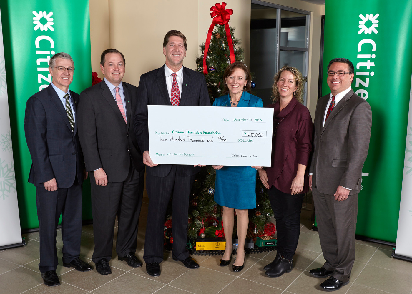 CITIZENS BANK LEADERSHIP celebrates the donation of $200,000 to the Citizens Charitable Foundation in 2016, which was distributed to nonprofits in 2017. From left: Citizens Bank officials Brad Conner, vice chairman, consumer banking, and Don McCree, vice chairman, commercial banking, join Bruce Van Saun, Citizens chairman and CEO; Barbara Cottam, chair of Citizens Charitable Foundation; Sasha Purpura of Food for Free; and David Caprio of Children's Friend and Service. / COURTESY CITIZENS BANK