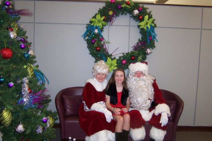 PICTURED AT INTERNATIONAL GAME Technology PLC's Breakfast with Santa are global solutions chairman Donald Sweitzer as Santa, his wife Sheri as Mrs. Clause and Hannah Wiczek, daughter of Angela Wiczek, IGT's vice president of corporate communications. / COURTESY INTERNATIONAL GAME TECHNOLOGY PLC