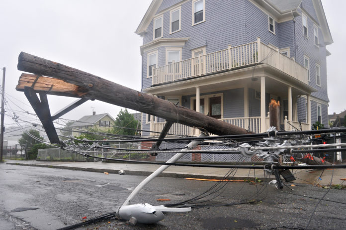 THE UNITED STATES recorded 15 weather events costing $1 billion or more each through early October, one short of the record 16 in 2011. Above, damage in Providence caused by Hurricane Irene in 2011. / PBN FILE PHOTO/FRANK MULLIN