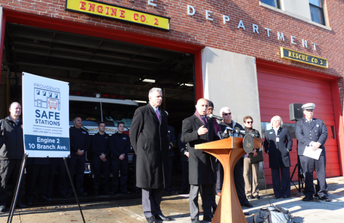 AT THE PODIUM, Mayor Jorge Elorza helps announce the launch of 12 'safe stations' for addiction referral in Providence fire stations. To his left, Providence Public Safety Commissioner Steven Pare. / COURTESY OFFICE OF THE MAYOR OF PROVIDENCE