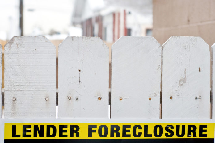 MASSACHUSETTS FORECLOSURE PETITIONS declined 53 percent year over year in October. / BLOOMBERG NEWS FILE PHOTO/DAVID CALVERT