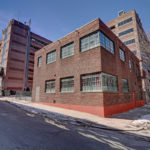 THE $995,000 SALE of this three-unit building, with loft-style apartments on each floor, at 147 South St. in Providence is the highest-priced multifamily sale in the city this year, / COURTESY RESIDENTIAL PROPERTIES LTD.