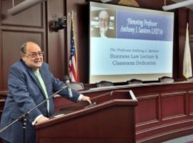ANTHONY J. SANTORO, professor, former president and founding dean of the Roger Williams University School of Law, speaks during a ceremony dedicating a law school classroom in his name. / COURTESY ROGER WILLIAMS UNIVERSITY