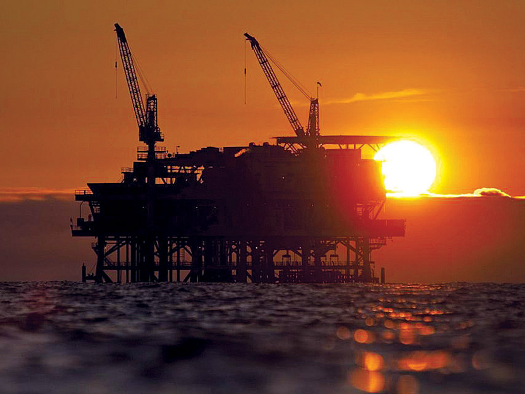 A BEAUTIFUL SIGHT? The proposal by the U.S. Department of the Interior to allow oil and gas drilling on all of the United States' continental shelf – such as this rig off the coast of Long Beach, Calif. – has brought swift negative reactions, including from Rhode Island officials. / BLOOMBERG NEWS FILE PHOTO/TIM RUE