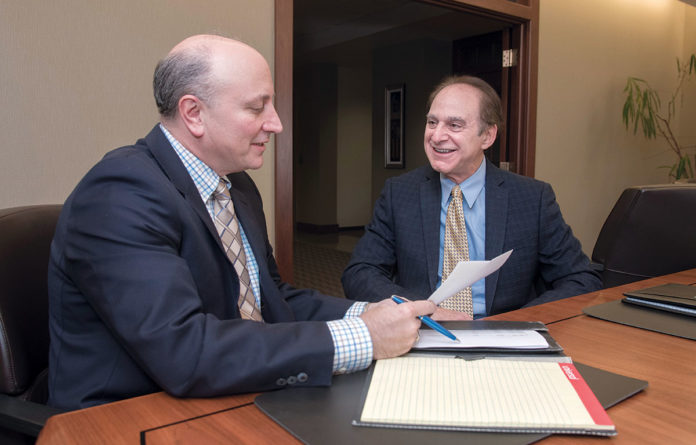 PARTNERS: From left, Emilio Colapietro of DiSanto, Priest & Co., and Steven Zaroogian, of Markarian & Meehan Ltd. The pair are managing partners of the two merging Rhode Island accounting firms. / PBN PHOTO/­MICHAEL SALERNO