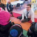 FLEXIBLE DOLLARS: David Caprio, president of Children's Friend, a nonprofit social service and education agency in Providence, speaks to the kids at Friendship Center. Caprio says although individual and corporate donations make up less than 10 percent of the nonprofit's budget, those are its most flexible dollars. / PBN PHOTO/MICHAEL SALERNO
