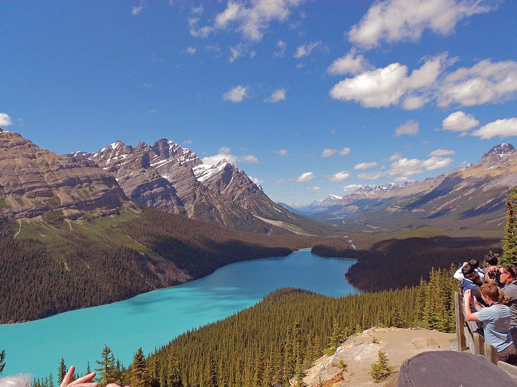 INTERNATIONAL TOUR: Visitors photograph the Canadian Rocky Mountains at Peyto Lake in Canada. The Canadian Rockies became Collette's first international tour when it offered an air-and-land package to the region in 1976. / COURTESY COLLETTE