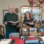 EDUCATIONAL EXPERIENCES: Timothy and Susan Magill of Narragansett, with the many photo albums from their eight different tours with Collette. The couple wants to learn from new cultures and continues to book with Collette because of the educational experiences. / PBN PHOTO/MICHAEL SALERNO