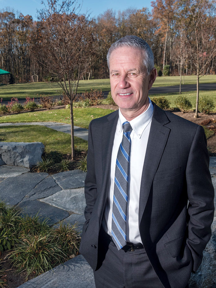 NEW PLOT: Anthony Hollingshead, president of Swan Point Cemetery in Providence, in the new burial section, which opened in December offering more landscaping, modern monuments, open land and new options for the customer. / PBN PHOTO/MICHAEL SALERNO