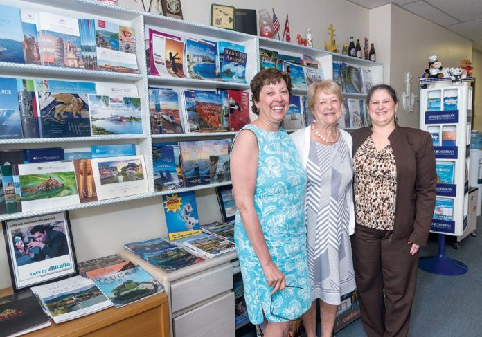 STILL GOING STRONG: From left, Colleen A. Keane, company manager at Anchor Travel Agency in Pawtucket; Nancy McAdams, owner and president; and Beverly J. Costello, travel consultant. Keane and McAdams have not completed a valuation and succession plan due to the emotion involved. / PBN FILE PHOTO/MICHAEL SALERNO