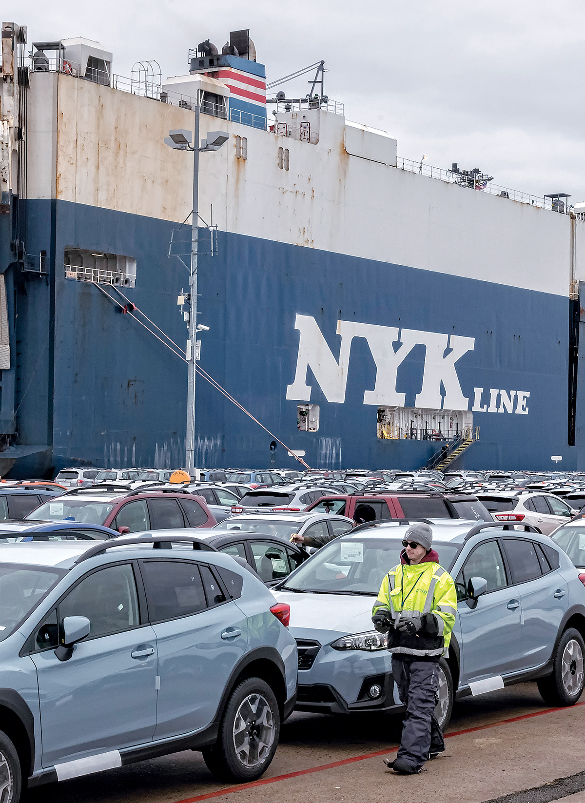 BUSY PORT: Ships unload cars being imported into the U.S. from overseas, at the NORAD facilities at the Port of Davisville in North Kingstown. Daniel Tofdoff, longshoreman, scans and tags vehicles / PBN PHOTO/MICHAEL SALERNO