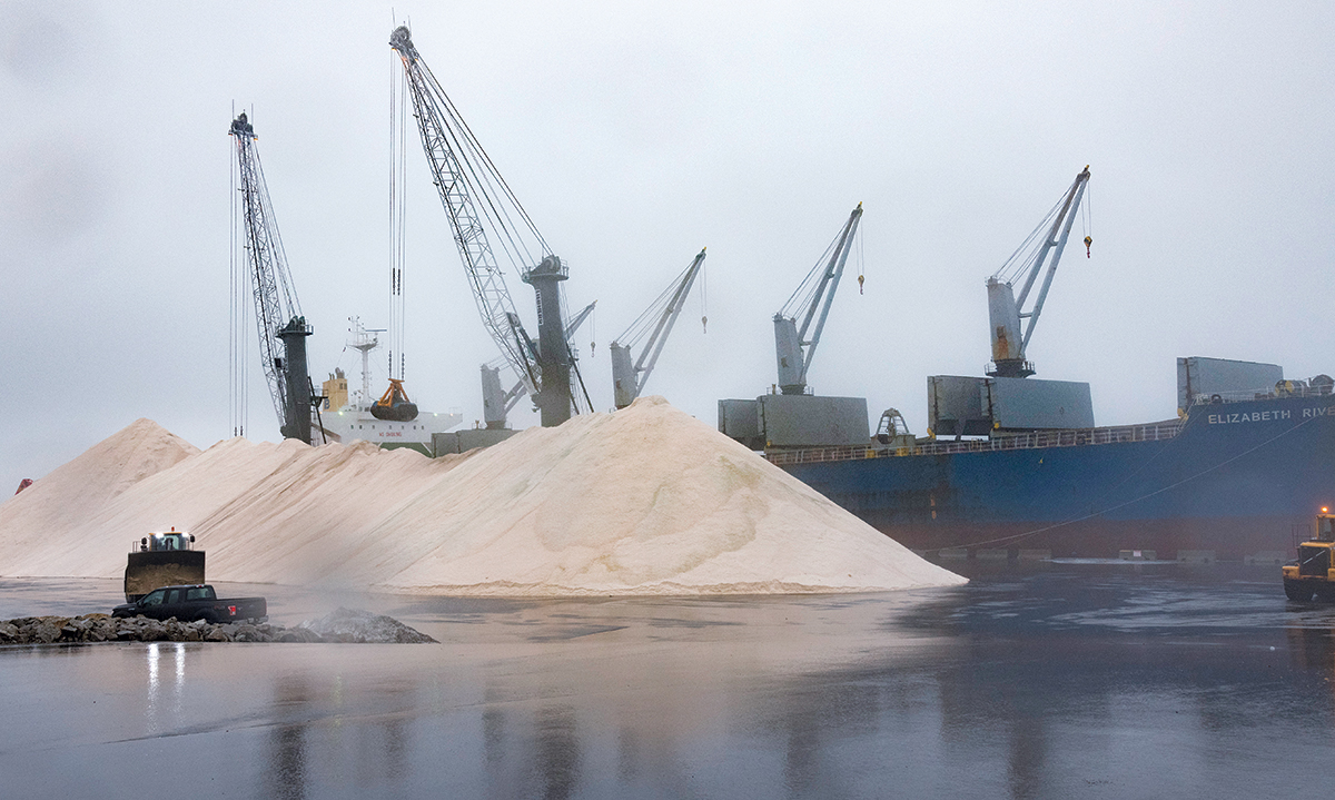 ICE MELT: The Elizabeth River, out of Hong Kong, offloads 60,000 tons of salt at the Port of Providence. The salt is sourced from the interior of Egypt and is used as ice melt. / PBN PHOTO/MICHAEL SALERNO