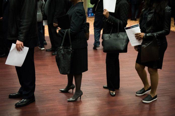 United States job openings fell in November to a six-month low . /BLOOMBERG FILE PHOTO/MARK KAUZLARICH