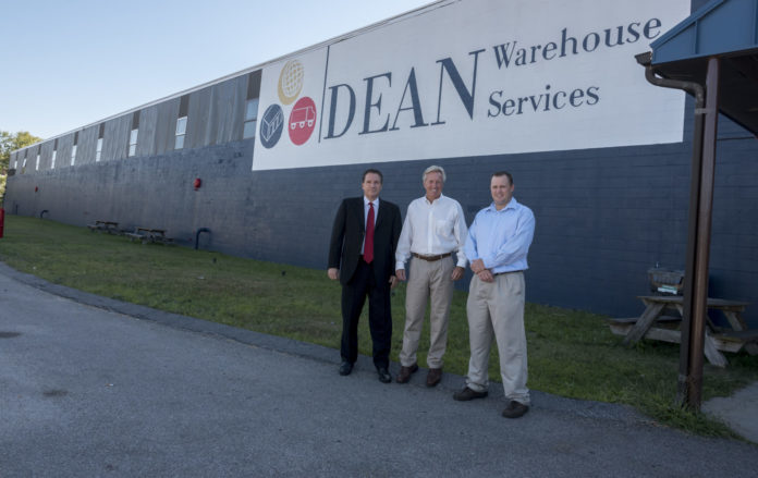 BRADFORD S. DEAN has been promoted to CEO and Joseph Iovini to President of Dean Warehouse Services, Inc. They are shown here, with company founder Bradford A. Dean, at the Warwick warehouse. From left, Joseph Iovini, president, Brad A. Dean, founder, and Brad S. Dean, CEO./ PBN FILE PHOTO/MICHAEL SALERNO