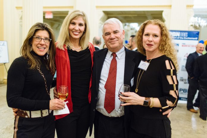 A SOCIAL SUCCESS: Attendees at PBN's annual Book of Lists party, held Wednesday at the Providence Public Library, were able to mingle and sample food and drink in the library's restored Beaux Arts spaces. From left, Jessica Granatiero, owner and operator of Savory Grape Wine Shop and The Savory Affair Event Planning; Suzanne Elsbecker, from Cox Business; Mark Scott, former vice president of Cox Business for the Northeast region; and Bronwyn Dannenfelser, director of resource development for WaterFire Providence. / PBN PHOTO/RUPERT WHITELEY
