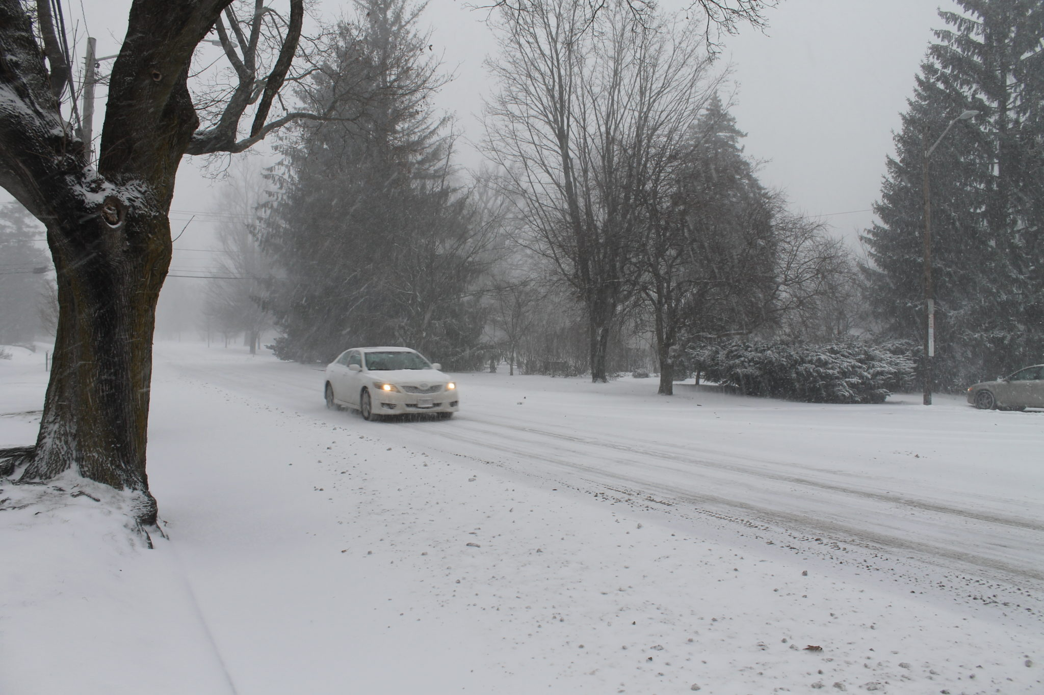A CAR HEADED SOUTH on Blackstone Boulevard Thursday as snow started to accumulate in Rhode Island. / PBN FILE PHOTO/MARY MACDONALD