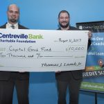 CENTREVILLE BANK HAS provided $260,000 to the Capital Good Fund to help fund the organization's lending operations. Centreville Bank Charitable Foundation, the bank's giving arm, donated an additional $10,000. Scott Sheppard, left, vice president of commercial lending at Centreville Bank, presents the $10,000 check to Andy Posner, founder and CEO of the Capital Good Fund. / COURTESY CENTREVILLE BANK
