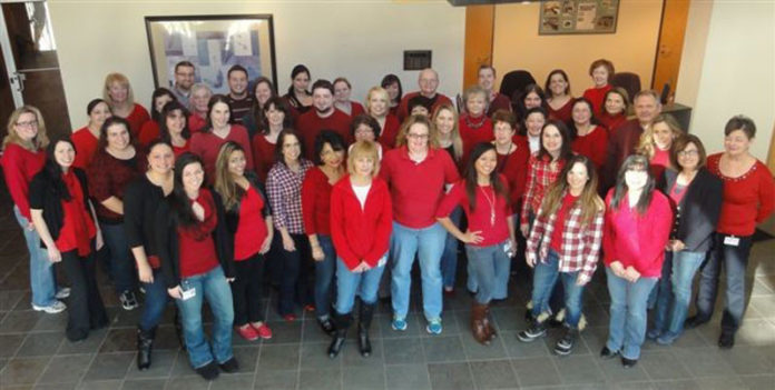 PAWTUCKET CREDIT UNION shows support for workers' heart health by participating in the 2014 Go Red for Women Day. This year's Go Red for Women Luncheon and Festival of Red will be held on Feb. 16 at the Rhode Island Convention Center in Providence. / COURTESY PAWTUCKET CREDIT UNION