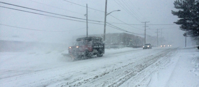 A PLOW TRUCK CLEARING THE ROADS on Elmwood Ave. in Cranston. / PBN FILE PHOTO/ROB BORKOWSKI