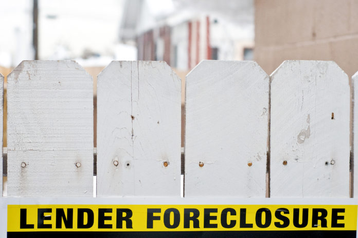 MORTGAGE DELINQUENCIES in the Providence metro area were 5.5 percent in October, a 0.7 percentage point decline from October 2016. / BLOOMBERG FILE PHOTO/DAVID CALVERT