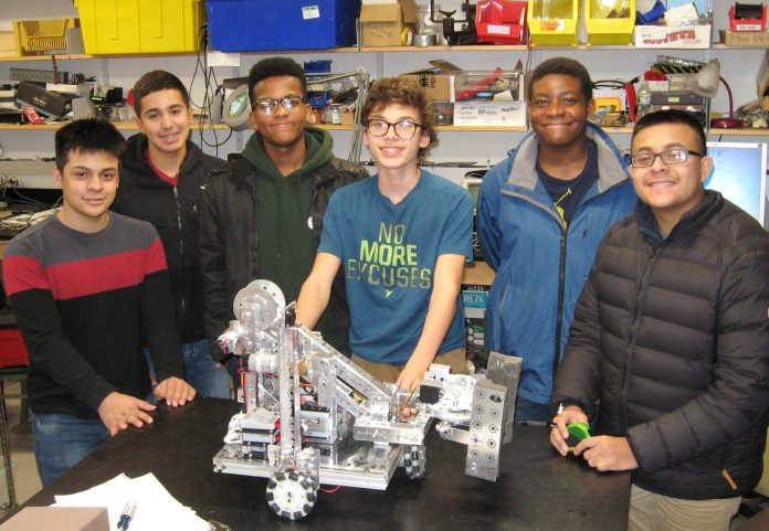 THE COLLEGE CRUSADE of Rhode Island's high school robotics team will compete in the 12th annual FIRST Tech Challenge at the New England Institute of Technology on Feb. 3. From left, Carlos Cancino of Cranston; Lisandro Nunez of Providence; Cesar Rosario of Providence; Harold Alexieff of Cranston; and Emmanual Imonah and Gerson Menjivar, both of Providence. / COURTESY THE COLLEGE CRUSADE
