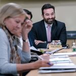 SELLING R.I.: Jesse Saglio, right, the new president and chief operating officer of R.I. Commerce Corp. at a recent public meeting of the agency's board. He says Commerce will step up its focus on helping local and small businesses this year. / PBN PHOTO/MICHAEL SALERNO