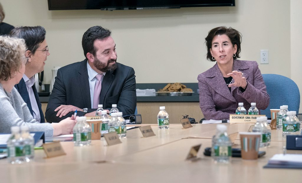ALL BUSINESS: Jesse Saglio, Commerce RI president, flanked on the left by board member Bernard Buonanno and, right, by Gov. Gina M. Raimondo. Saglio says the agency's incentive programs focus on pay for performance. / PBN PHOTO/MICHAEL SALERNO