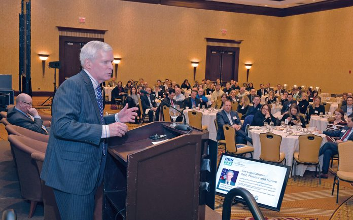 CONCERNED: Keynote speaker Mark W. Everson, vice chairman of alliantgroup, a Texas-based tax-services provider, addresses the crowd at the Providence Business News 2018 Tax Reform Summit. He says the growing budget deficit is a top concern. / PBN PHOTO/MIKE SKORSKI