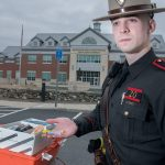 PREPARED: R.I. State Police Trooper Brendan Morgan with his opioid overdose kit and supply of naloxone that he needs to have for his patrol. / PBN PHOTO/­MICHAEL SALERNO
