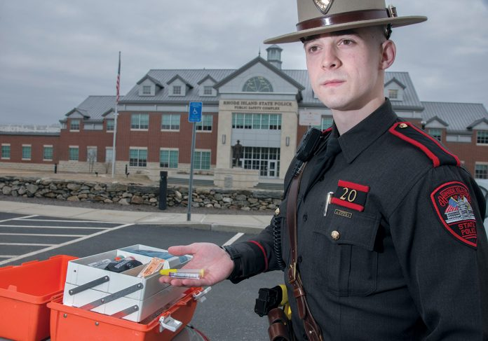 PREPARED: R.I. State Police Trooper Brendan Morgan with his opioid overdose kit and supply of naloxone that he needs to have for his patrol. /  PBN PHOTO/MICHAEL SALERNO