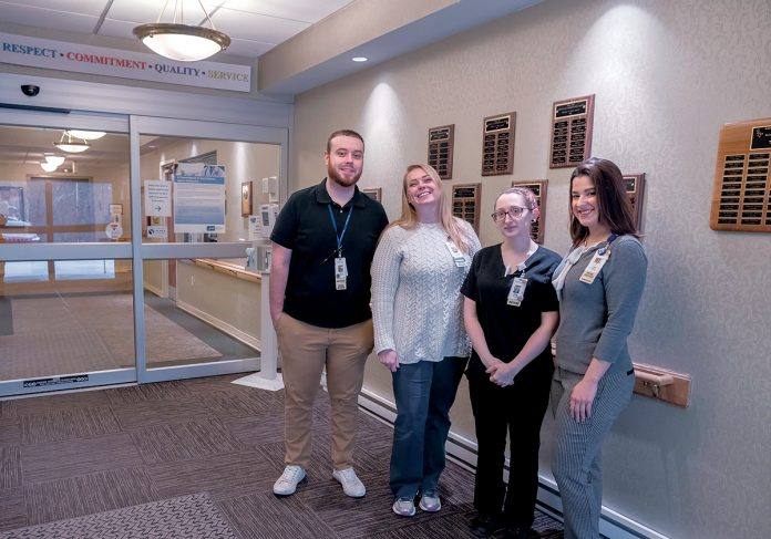 SAFE ZONE: Blue Cross & Blue Shield of Rhode Island has added West View Nursing & Rehabilitation Center in West Warwick to its growing list of LGBTQ Safe Zone certified providers. From left, Matthew Cooper, activities and social services; Pam Masciarott, social worker; Rachel Rodas, dietary aid; and Erica Lewis, social worker. / PBN PHOTO/­MICHAEL SALERNO