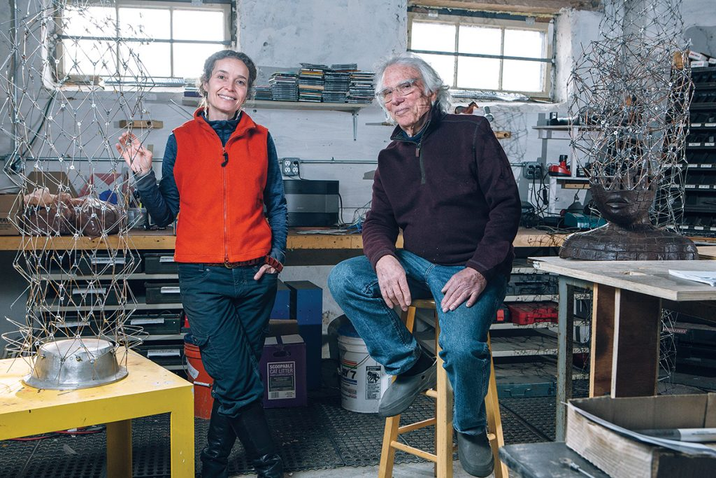 PROLIFIC SCULPTORS: Providence sculptors Brower Hatcher, right, and Marly Rogers, in Hatcher's studio in South Providence. / PBN PHOTOS/RUPERT WHITELEY