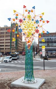 Cosmic Flower, by Providence sculptors Brower Hatcher, right, and Marly Rogers, at Emmett Square in Providence, is one of nearly 50 works of public art throughout the U.S. the pair has created. / PBN PHOTOS/RUPERT WHITELEY