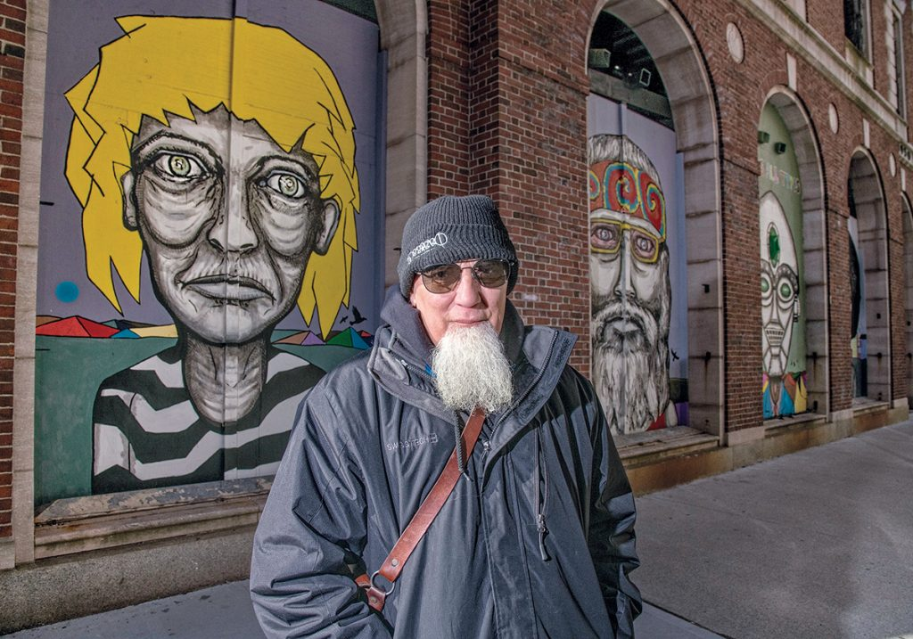 A CELEBRATION AND AN INTERVENTION: AS220 founder Bert Crenca has installed a series of five murals on the historical façade of the Providence National Bank in the city to celebrate the city's diversity.  / PBN PHOTO/