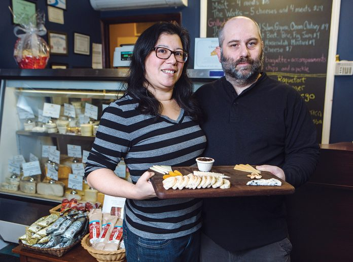 SAY CHEESE: Casey and Adrienne D'Arconte opened Edgewood Cheese Shop and Eatery in Cranston in May 2015, offering imported and domestic cheeses, crackers and select charcuterie, as well as a dine-in menu. / PBN PHOTO/RUPERT WHITELEY