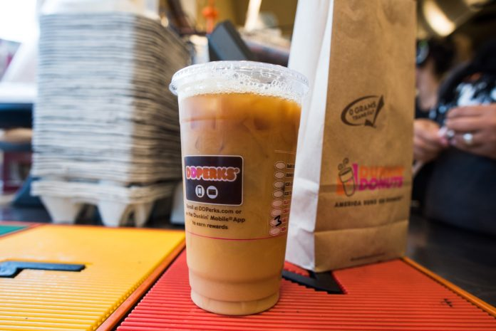 DUNKIN' BRANDS GROUP reported a $350.9 million profit for 2017, driven by a beneficial effect to tax liabilities caused by the recent federal tax code changes. / BLOOMBERG FILE PHOTO/RON ANTONELLI