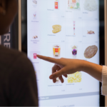 TOUCH-SCREEN kiosks now guide customers through placing their orders at the Atwood Avenue McDonald's restaurant in Johnston. / COURTESY MCDONALD'S