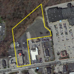This nearly 5-acre site will be redeveloped into new retail uses. It now is the location of the Fred W. Smith Inc. car sales business./SWEENEY REAL ESTATE & APPRAISAL.