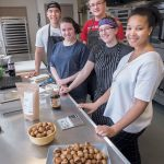 SPENT GRAIN: OurGrain is a startup that reuses grain from beer-making to create other products, such as bagel bites and cookies. Co-founders from left: (rear) ­Victor Eng and Sam Burges, (front) ­Samantha Gannon, Nicole Gresko and Natasha B. Daniels. / PBN PHOTO/MICHAEL SALERNO