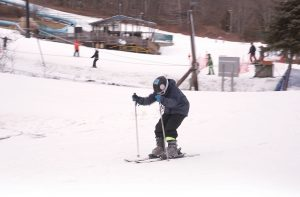 SLOPE RUN: A skier enjoys the slopes at Yawgoo Valley in Exeter. CEO Tracy Hartman says the park sees between 17,000 and 22,000 skiers in any given year. / PBN PHOTO/BRIAN MCDONALD