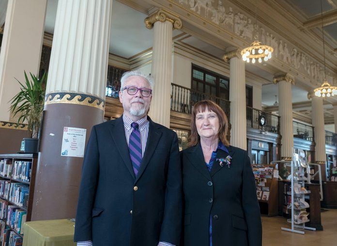 KNIGHT STEWARDS: Jeffrey Cannell, library director of the Providence Community Library network, and Sue Gibbs, chief operating officer, inside the Knight Memorial Library, which has received $544,800 from the Champlin Foundation to go toward much-needed renovations. / PBN PHOTO/­MICHAEL SALERNO