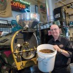"SUCCESSION PLAN: Bob Mastin, owner of Custom House Coffee in Middletown, has slowly been transferring ownership of the company over the past 15 months to employees. His goal is to turn over ownership to ""the key people"" that want to carry on the company after he steps down. / PBN PHOTO/KATE WHITNEY LUCEY"