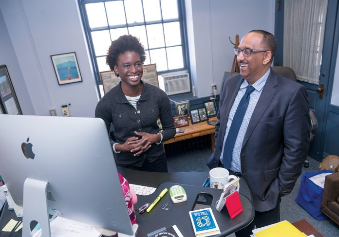PROACTIVE: Nasser Zawia, dean of the University of Rhode Island Graduate School, speaks with Alycia Mosley Austin, associate director, interdisciplinary neuroscience program associate dean, recruitment and diversity initiatives. Zawia and other administrators sent welcoming messages to international student applicants to counter the unwelcoming messages from the Trump administration. / PBN PHOTO/MICHAEL SALERNO