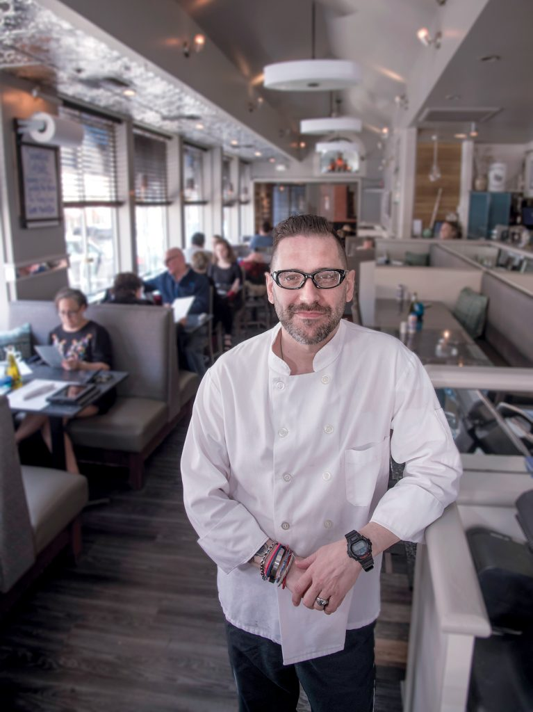 BACK IN BUSINESS: Nick Makris is the owner of Greek-American restaurant Andreas in Providence, which just reopened after extensive renovations following a burst pipe in January. / PBN PHOTO/MICHAEL SALERNO